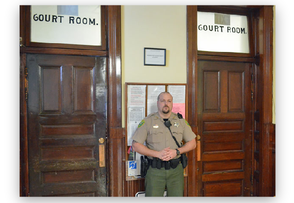 A Civil Division Deputy performing court room security during a session of Superior Court.