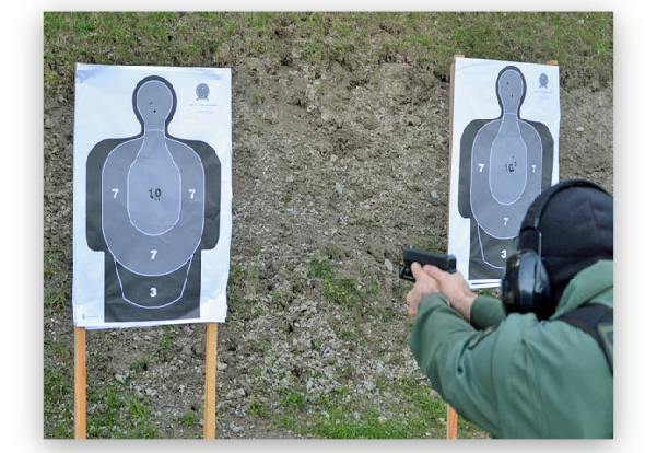 Deputy demonstrates proficiency with his handgun during a firearms training sessions